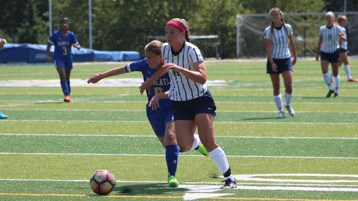 Brescia's Nciole Gray battles for control with Courtney Denney of Marian